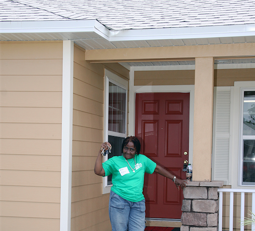 habitiat for humanity homeowner partner showing off keys to new home