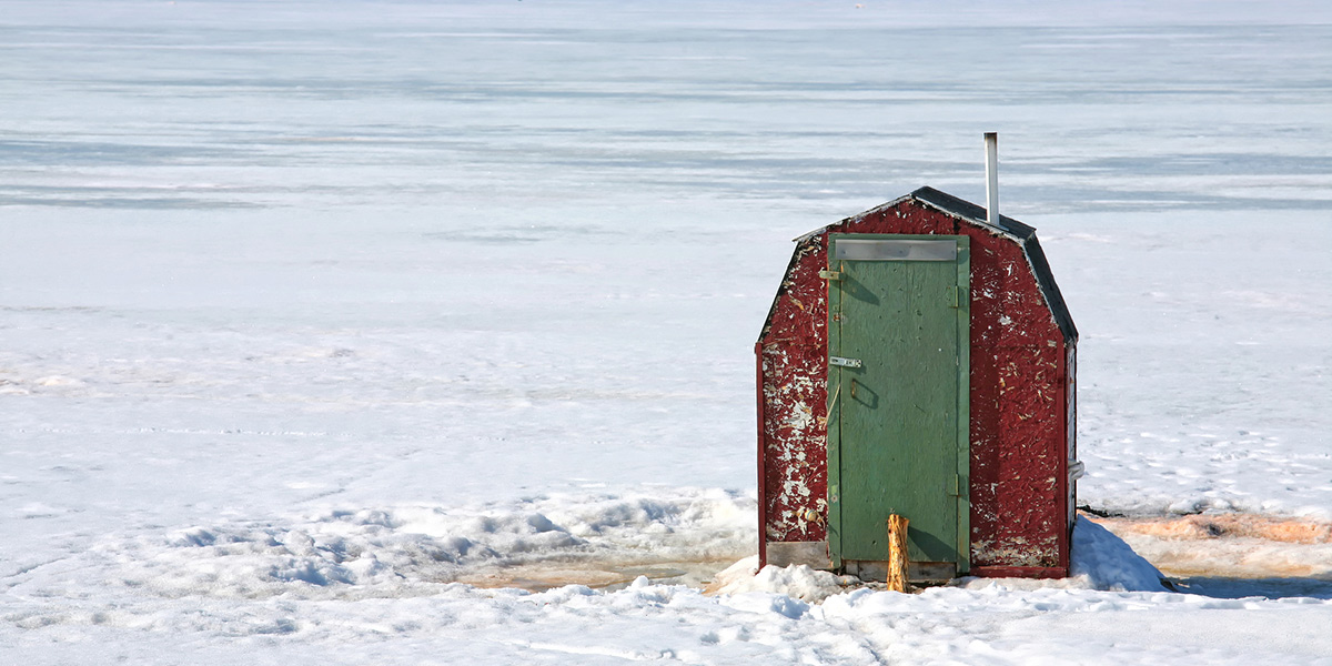 ice fishing shack on lake