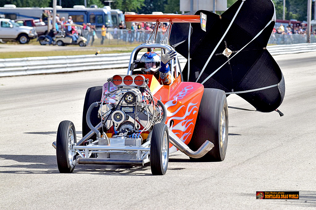 Buddy Hull Racing red nitro flame car coming to a stop