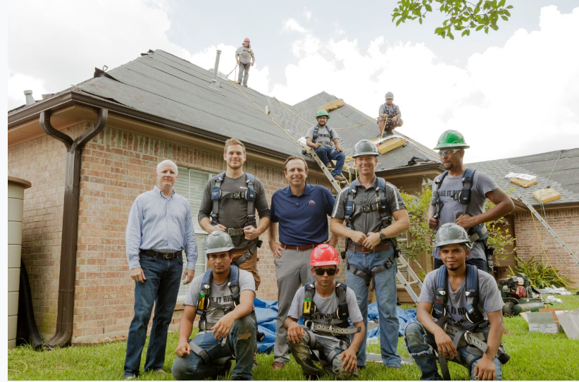 Mike Jr. with George, homeowner and crew